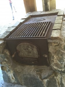 A grill, uses fire wood.